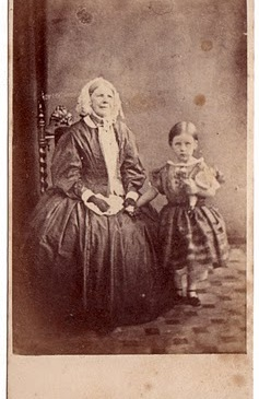 Woman with child and her doll, photo by Charles A. Woolley 1860s