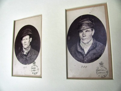 Mugshots by T. J. Nevin 1875 of prisoners in grey uniforms and leather caps, SLNSW Mitchell Collection