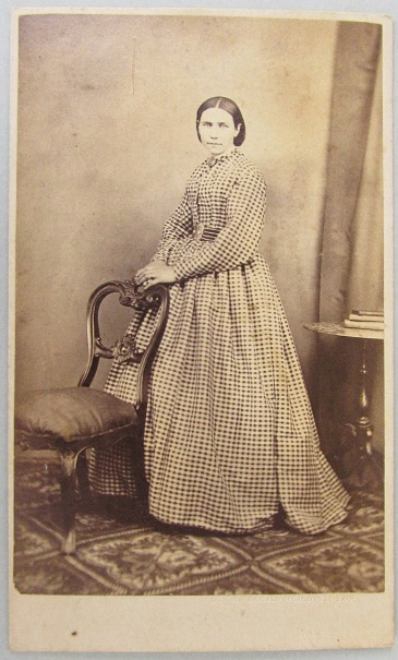Woman in dress with check pattern