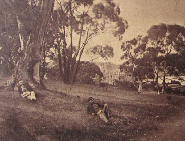 A supine Thomas Nevin and friend on the Domain 1868