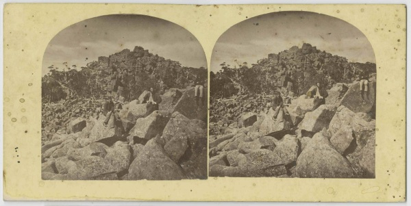 Three men sitting on boulders, kunanyi/Mt. Wellington