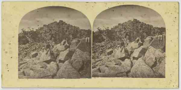 Three men sitting on boulders, kunanyi/Mt Wellington